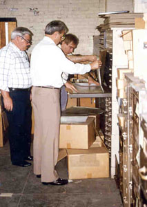 Photo of Jay Lewis, Jack Heath and Chuck Decanic looking over the early Remington records.