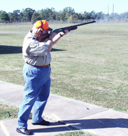 RSA Director Lee Estabrook powders a clay target on the Trap Range.